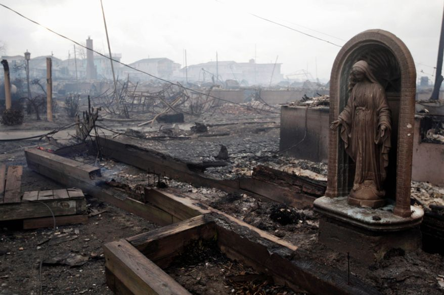 Damage caused by a fire in the Breezy Point section of the Queens borough of New York is shown on Tuesday, Oct. 30, 2012. The fire department sent more than 190 firefighters to the blaze caused by superstorm Sandy.  (AP Photo/Frank Franklin II)
