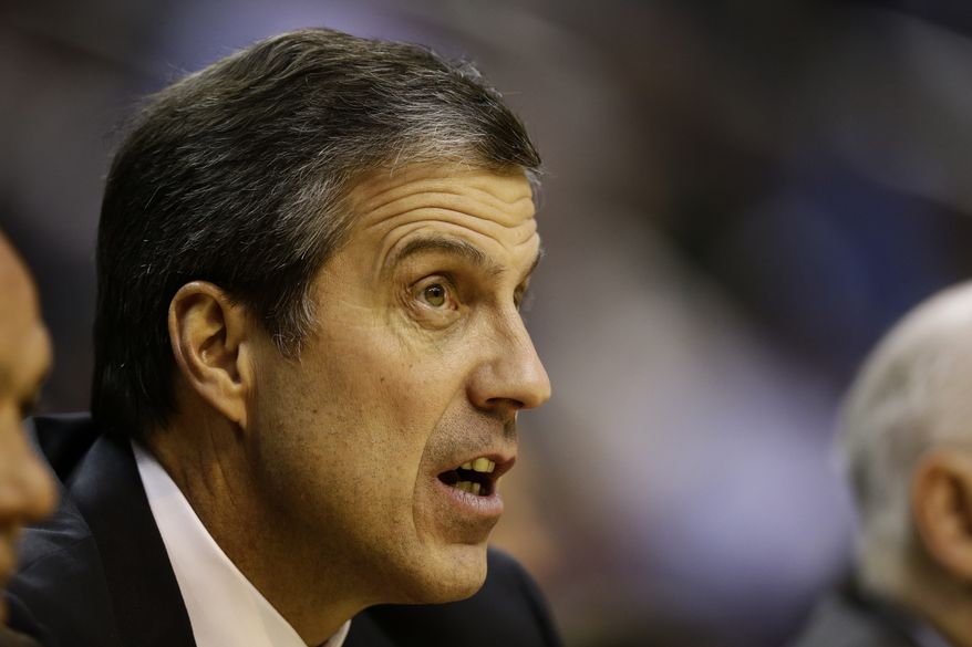 Washington Wizards head coach Randy Wittman watches his team from the bench in the second half of an NBA basketball game against the San Antonio Spurs Monday, Nov. 26, 2012, in Washington. The Spurs won 118-92. (AP Photo/Alex Brandon)