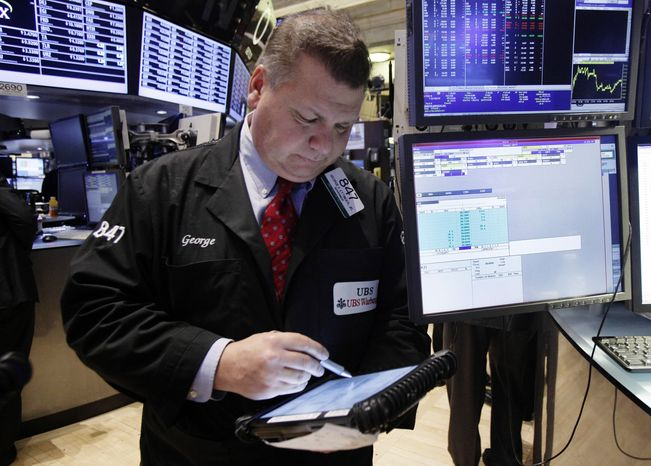 Trader George Ettinger works on the floor of the New York Stock Exchange on Dec. 11, 2012. (Associated Press)