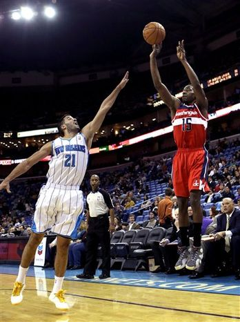 Washington Wizards guard Jordan Crawford (15) shoots over New Orleans Hornets guard Greivis Vasquez (21) in the first half of an NBA game in New Orleans, Tuesday, Dec. 11, 2012. The Wizards won 77-70. (AP Photo/Gerald Herbert)