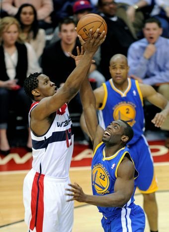 Golden State Warriors guard Charles Jenkins (22) battles for the ball against Washington Wizards forward Kevin Seraphin (13) during the second half of the Warriors' 101-97 win on Dec
