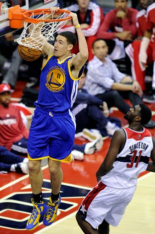 Golden State Warriors guard Klay Thompson (11) dunks against Washington Wizards forward Chris Singleton during the second half of the Warriors' 101-97 win on Dec. 8, 2012, in Washington. (Associated Press)