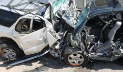 ** FILE ** This photo provided by the National Transportation Safety Board shows a post-accident view of the vehicles from a wrong-way collision in Fountain, Colo., on Sept. 24, 2011. Hundreds of people are killed each a year when drivers turn the wrong way into the face of oncoming traffic on high-speed highways, and a majority of the crashes involves drivers with blood alcohol levels more than twice the legal limit, a federal accident researcher said. (Associated Press/National Transportation Safety Board)
