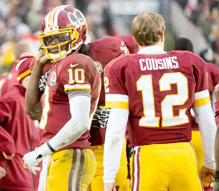 Redskins quarterback Robert Griffin III (left) tested his injured knee during practice Wednesday, but no indication was given whether he would be taking the snaps Sunday at Cleveland. Waiting in the wings is Kirk Cousins, who guided Washington to a comeback win over Baltimore last Sunday. (Andrew Harnik/The Washington Times)