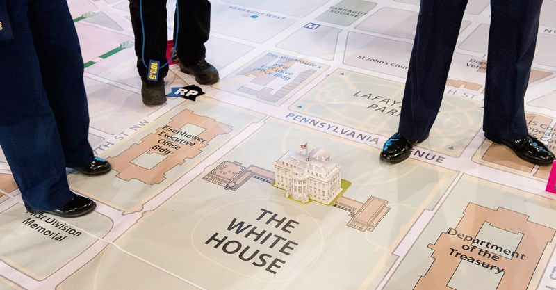 Members of the media crowd around a model of the White House as the Joint Task Force - National Capital Region and the D.C. National Guard hold a final inauguration day planning symposium using a 40- by 60-foot map of downtown D.C. and the National Mall, Washington, D.C., Wednesday, December 12, 2012. The inauguration day events are planned out for months with a number of different military and civilian organizations. (Andrew Harnik/The Washington Times)