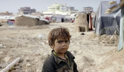 An displaced Afghan child stands at a refugee camp on the outskirts of Kabul, Afghanistan, on Wednesday, Dec. 12, 2012. More than 2 million Afghans are at risk from cold, disease and malnutrition this winter as an international appeal for funds to help one of the world's poorest countries has fallen drastically short of its goal, the United Nations and several humanitarian agencies warned on Wednesday. (AP Photo/Musadeq Sadeq)