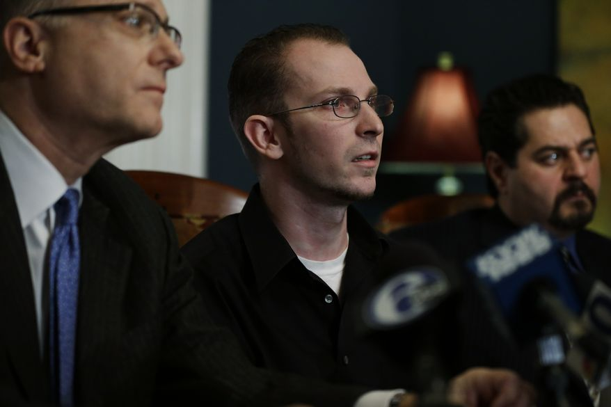 Plaintiff Melvin Novak (center), flanked by attorneys Stewart J. Eisenberg (left) and Dino Privitera, speaks during a news conference on Wednesday, Dec. 12, 2012, in Philadelphia. Mr. Novak has filed a sexual abuse lawsuit against the Boy Scouts of America, the Church of Jesus Christ of Latter-day Saints and a former scoutmaster convicted of molesting him when Mr. Novak was 15. (AP Photo/Matt Rourke)