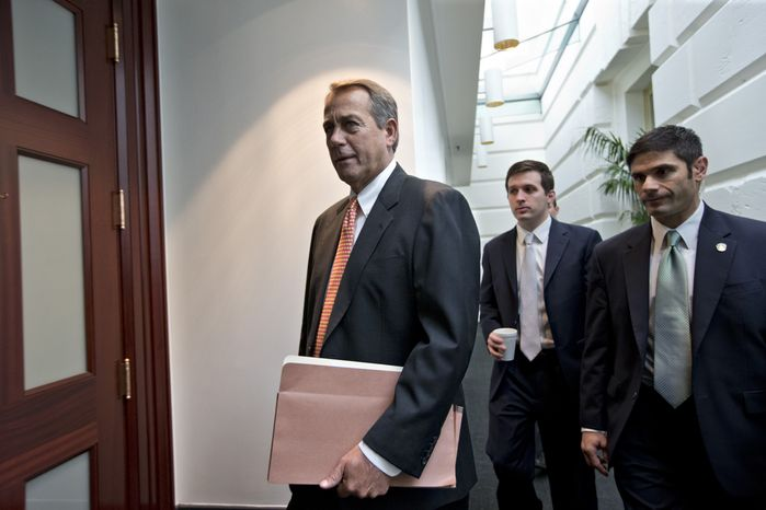 "House Speaker John Boehner, Ohio Republican, arrives Dec. 12, 2012, for a closed-door meeting with the GOP caucus on Capitol Hill in Washington. Boehner and the other House Republican leaders are calling for President Obama to come up with plan they can accept for spending cuts and tax revenue to avoid the so-called ""fiscal cliff"" of automatic tax hikes and budget redu"