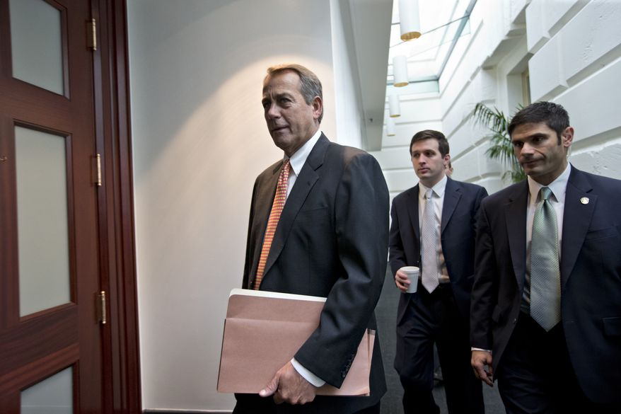 "House Speaker John Boehner, Ohio Republican, arrives Dec. 12, 2012, for a closed-door meeting with the GOP caucus on Capitol Hill in Washington. Boehner and the other House Republican leaders are calling for President Obama to come up with plan they can accept for spending cuts and tax revenue to avoid the so-called ""fiscal cliff"" of automatic tax hikes and budget reductions. (Associated Press)"