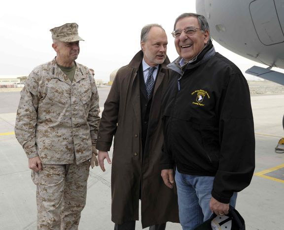U.S. Defense Secretary Leon Panetta, right, smiles as he is greeted by U.S. Ambassador to Afghanistan James B. Cunningham, center, and Marine Gen. John R. Allen, left, commander of International Security Assistance Force, upon arriving at Kabul International Airport in Kabul, Afghanistan, Wednesday, Dec. 12, 2012. (AP Photo/Susan Walsh, Pool)
