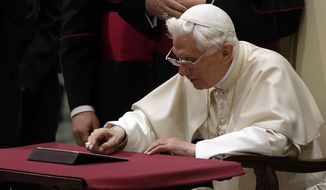 """Pope Benedict XVI pushes a button on a tablet at the Vatican last December. In perhaps the most drawn out Twitter launch ever, Pope Benedict XVI pushed the button on a tablet brought to him at the end of his general audience Wednesday. It read: """"Dear friends, I am pleased to get in touch with you through Twitter. Thank you for your generous response. I bless all of you from my heart."""" (AP Photo/Gregorio Borgia)"""