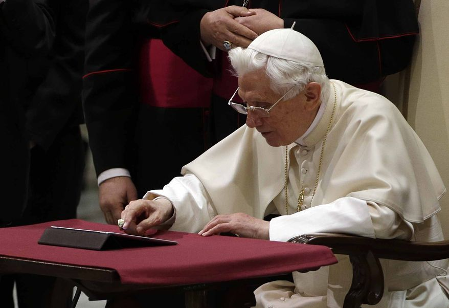 "Pope Benedict XVI pushes a button on a tablet at the Vatican last December. In perhaps the most drawn out Twitter launch ever, Pope Benedict XVI pushed the button on a tablet brought to him at the end of his general audience Wednesday. It read: ""Dear friends, I am pleased to get in touch with you through Twitter. Thank you for your generous response. I bless all of you from my heart."" (AP Photo/Gregorio Borgia)"