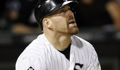 FILE - In this Aug. 21, 2012, file photo, Chicago White Sox's Kevin Youkilis watches his grand slam off a pitch by New York Yankees' Ivan Nova during the fifth inning of a baseball game in Chicago. A person familiar with the negotiations told The Associated Press Tuesday, Dec. 11, that free agent Youkilis and the New York Yankees have reached agreement on a $12 million, one-year deal. (AP Photo/Charles Rex Arbogast, File)