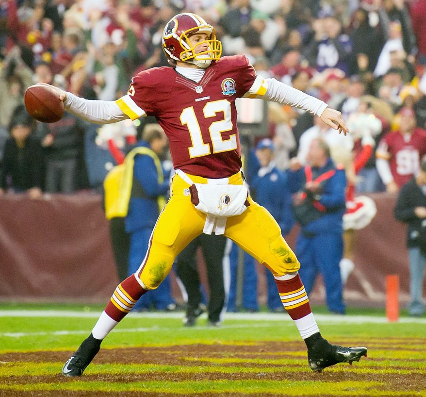 ** FILE ** Washington Redskins quarterback Kirk Cousins (12) spikes the ball after running the ball in for a two point conversion to send the game into overtime as the Washington Redskins play the Baltimore Ravens at Fedex Field, Landover, Md., Sunday, December 9, 2012. (Andrew Harnik/The Washington Times)
