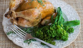 Extra credit goes to the cook who takes the time to make a creamy mustard sauce to serve with herb-roasted Cornish game hens for the holiday. Evaporated skim milk can be used in the sauce as a low-fat alternative. (Associated Press)