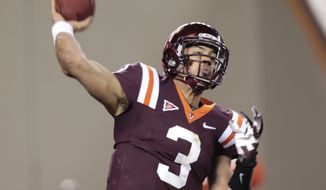 Virginia Tech quarterback Logan Thomas (3) tosses the ball during the first half of a NCAA college football game in Blacksburg, Va., Thursday, Nov. 8, 2012. (AP Photo/Steve Helber)
