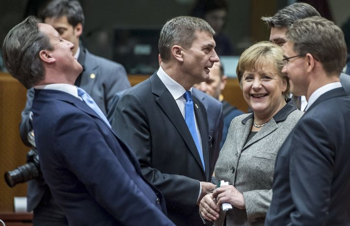 British Prime Minister David Cameron (left) laughs as he speaks with (from right) Finland's Prime Minister Jyrki Tapani Katainen, Croatian Prime Minister Zoran Milanovic, German Chancellor Angela Merkel and Estonia's Prime Minister Andrus Ansip during a round table meeting at an EU summit in Brussels on Dec. 13, 2012. (Associated Press)