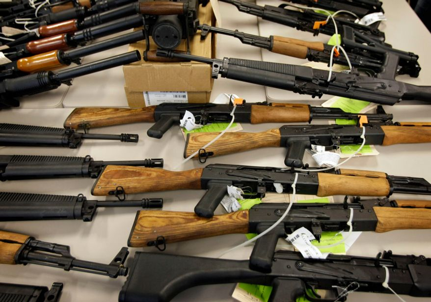 "** FILE ** Part of a cache of seized weapons is displayed Jan. 25, 2011, at a news conference in Phoenix. The ATF received fire over a Phoenix-based gun-trafficking investigation called ""Fast and Furious,"" in which agents allowed hundreds of guns into the hands of straw purchasers in hopes of making a bigger case. Two of those weapons were found in December at the fatal shooting of U.S. Border Patrol agent Brian Terry. (Associated Press)"