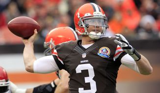 Cleveland Browns quarterback Brandon Weeden passes against the Kansas City Chiefs in the first quarter of an NFL football game Sunday, Dec. 9, 2012, in Cleveland. (AP Photo/Tony Dejak)