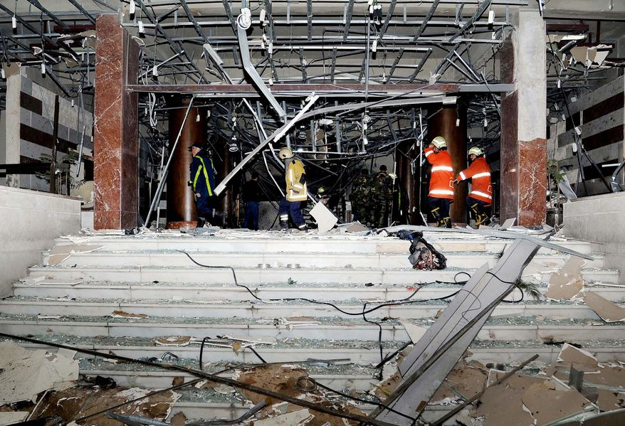 This Wednesday, Dec. 12, 2012, photo released by the Syrian official news agency SANA, shows damages after an explosion hit the main gate of the Syrian Interior Ministry in Damascus, Syria. Three bombs collapsed walls in the Syrian Interior Ministry building Wednesday in Damascus, killing several, as rebels fighting to overthrow President Bashar Assad edged closer to the capital, the symbol of his power. (AP Photo/SANA)