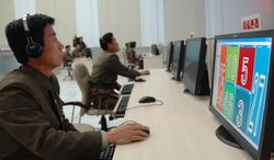 Scientists and technicians work on their computers to control the launch of North Korea's Unha-3 rocket at the General Satellite Control and Command Center in Pyongyang, North Korea, on Dec. 12, 2012. (Associated Press)