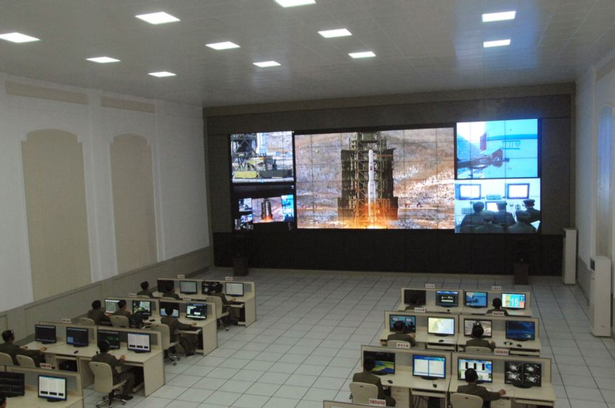 Scientists and technicians at the General Satellite Control and Command Center on the outskirts of Pyongyang watch the launch of the Unha-3 rocket from a launch site on the west coast, in the village of Tongchang-ri, about 56 kilometers (35 miles) from the Chinese border city of Dandong, North Korea, on Dec. 12, 2012. (Associated Press)