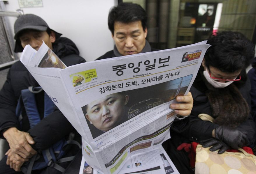 "A South Korean man reads a newspaper Dec. 13, 2012, on a subway train in Seoul. The newspaper's headline reports North Korea's successful rocket launch the previous day, defying international warnings as the regime of Kim Jong Un took a big step forward in its quest to develop a nuclear missile. The headline reads ""Kim Jung Un's gambling, Obama to aim."" (Associated Press)"