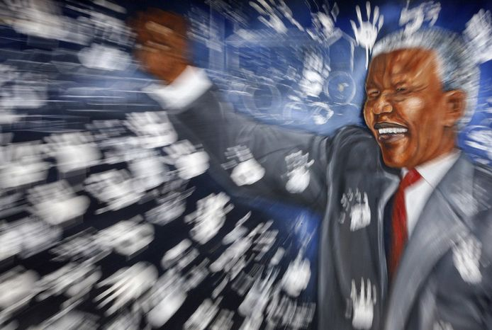 ** FILE ** This mural depicting former South African President Nelson Mandela is shown at the Alexandra township in Johannesburg, South Africa, Tuesday, Dec. 11, 2012, to honor Mandela's 94th birthday, which was celebrated on Wednesday, July 18, 2012. (AP Photo/Themba Hadebe)