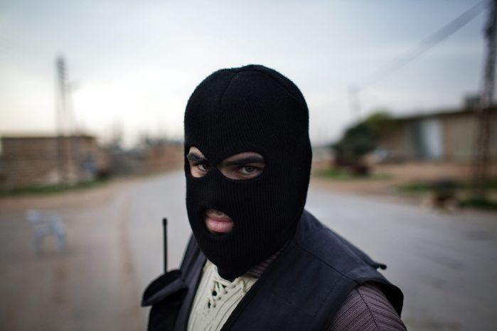 A Kurdish member of the FSA is seen at a check point in Fafeen village, north of Aleppo province, Syria, on Dec. 12, 2012. (Associated Press)