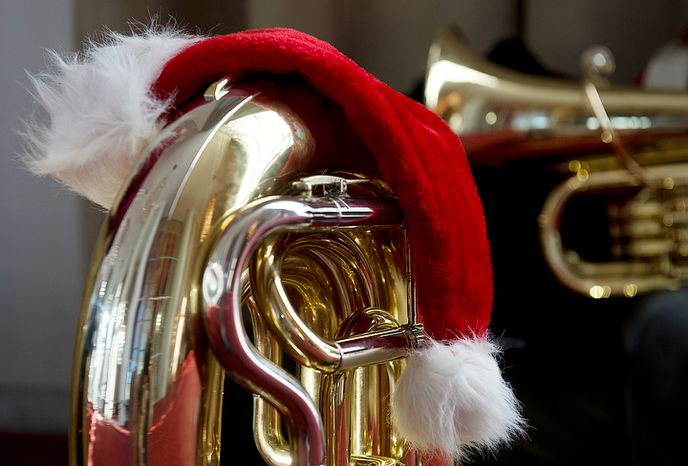"""A Santa Claus hat rests on """"Estelle"""" the tuba, which belongs to Larry Wile of Silver, Spring, Md. He was one of hundreds of tuba players who came to the Kennedy Center in Washington, D.C. on Thursday, Dec. 13, 2012 to participate in Tuba Christmas, a concert that originated in 1974 as a tribute to the late artist/teacher William J. Bell, who was born on Christmas Day in 1902.  (Barbara L. Salisbury/The Washington Times)"""