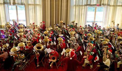 Hundreds of tuba players rehearse at the Kennedy Center in Washington, D.C. on Thursday, Dec. 13, 2012 before Tuba Christmas, a concert that originated in 1974 as a tribute to the late artist/teacher William J. Bell, who was born on Christmas Day in 1902. (Barbara L. Salisbury/The Washington Times)