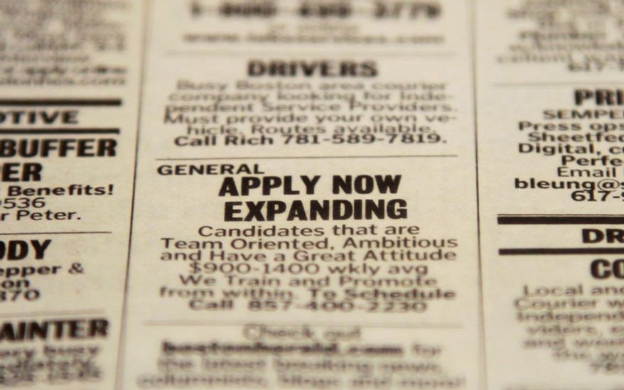 An advertisement in the classified section of the Boston Herald newspaper calls attention to possible employment opportunities in a Tuesday, Dec. 11, 2012, photo taken in Walpole, Mass. (AP Photo/Steven Senne)