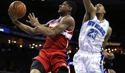 Washington Wizards shooting guard Bradley Beal (3) drives to the basket in front of New Orleans Hornets power forward Anthony Davis (23) in the first half of an NBA basketball game in New Orleans, Tuesday, Dec. 11, 2012. (AP Photo/Gerald Herbert)