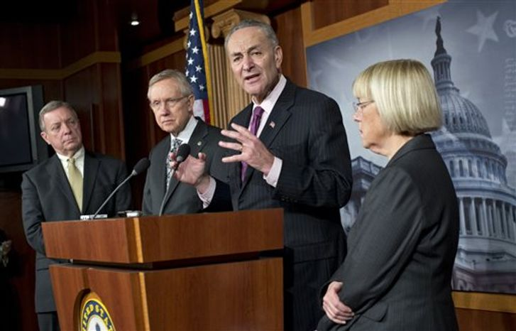 During a press conference to discuss the fiscal cliff negotiations and other unfinished legislation, Sen. Charles Schumer, D-N.Y., reminds his Senate colleagues to help him to get federal disaster assistance to help the people of New York recover from Hurricane Sandy, at the Capitol in Washington, Thursday, Dec. 13, 2012. From left to right are Sen. Dick Durbin, D-Ill., Senate Majority Leader Harry Reid, D-Nev., Sen. Charles Schumer, D-N.Y., and Sen. Patty Murray, D-Wash.  (AP Photo/J. Scott Applewhite)