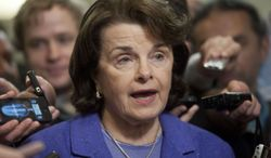 **FILE** Senate Intelligence Committee Chair Sen. Dianne Feinstein, California Democrat, is surrounded by reporters on Capitol Hill in Washington on Nov. 16, 2012, following a closed-door hearing of the committee where former CIA Director David Petraeus testified. (Associated Press)
