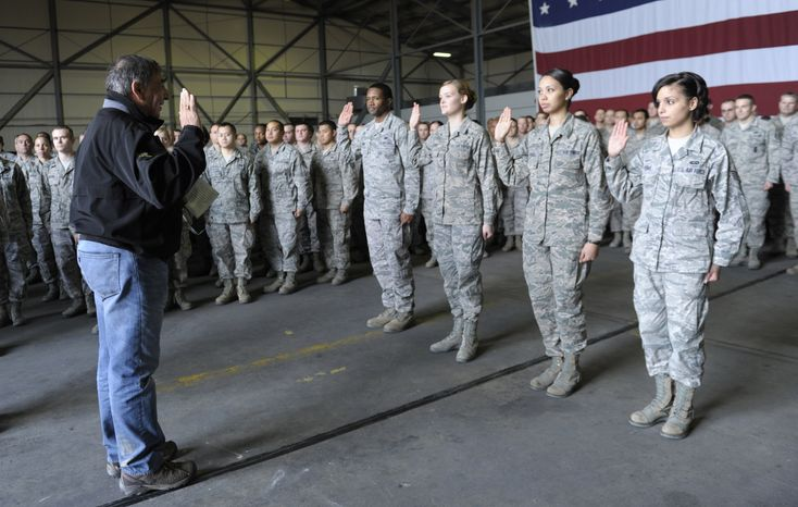 Defense Secretary Leon Panetta performs a swear-in ceremony to reenlist four troops during his visit to Incirlik Air Base, Turkey, on Dec. 14, 2012. Panetta is heading home after spending three days in Afghanistan meeting with troops, commanders and Afghani leaders. (Associated Press)