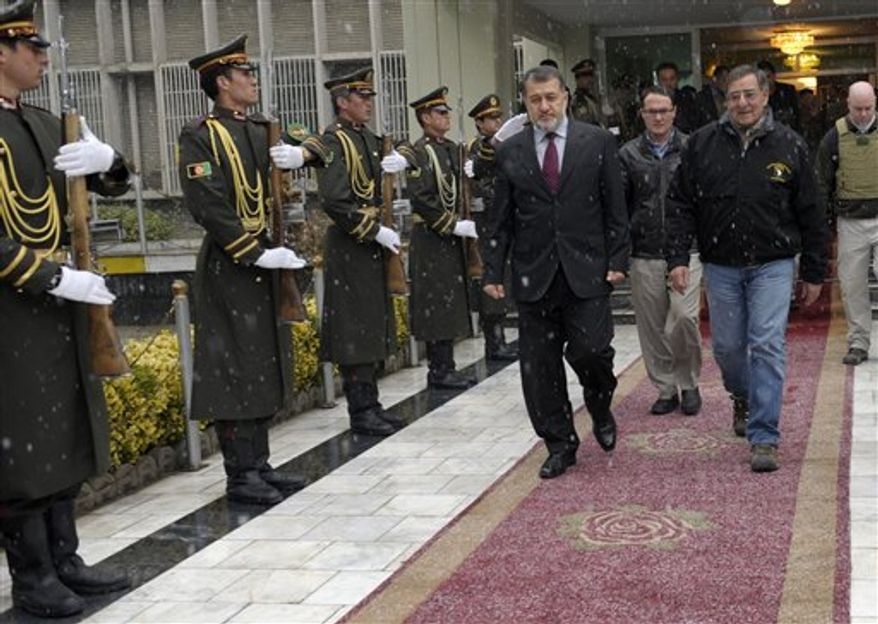 U.S. Defense Secretary Leon Panetta walks out with Afghanistan's Defense Minister Gen. Bismillah Khan Mohammadi following their meeting in Kabul, Afghanistan, Thursday, Dec. 13, 2012. (AP Photo/Susan Walsh, Pool)