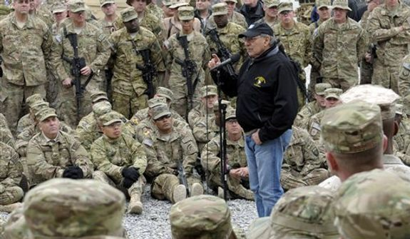 U.S. Defense Secretary Leon Panetta speaks to the troops during a visit to Kandahar Airfield in Kandahar, Afghanistan, Thursday, Dec. 13, 2012.  (AP Photo/Susan Walsh, Pool)