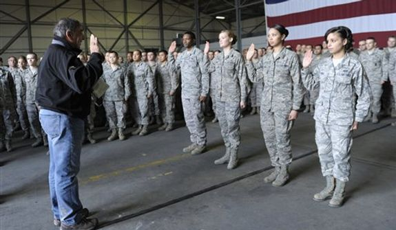 Defense Secretary Leon Panetta performs a swearing in ceremony to reenlist four troops during his visit to Incirlik Air Base, Turkey, Friday, Dec. 14, 2012. Panetta is heading home after spending three days in Afghanistan meeting with troops, commanders and Afghani leaders. (AP Photo/Susan Walsh, Pool)