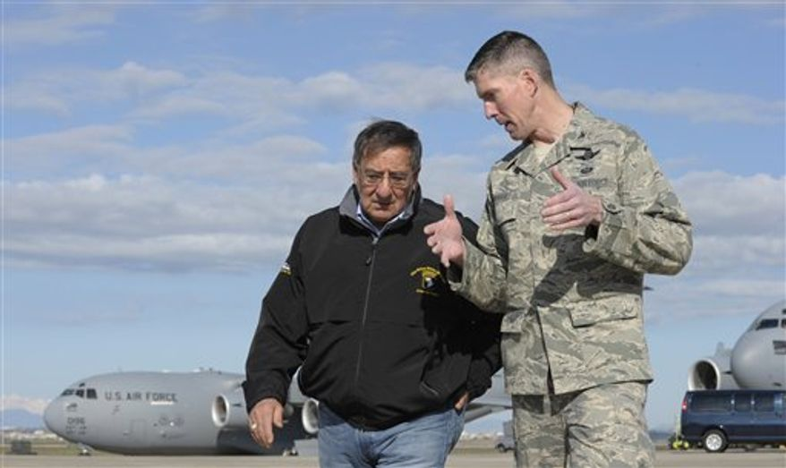 Defense Secretary Leon Panetta (left) talks with Col. Christopher E. Craige, Commander of the 39th Air Base Wing at Incirlik Air Base in Turkey on Dec. 14, 2012. Panetta stopped to visit troops in Turkey before heading home after spending three days in Afghanistan. (Associated Press)