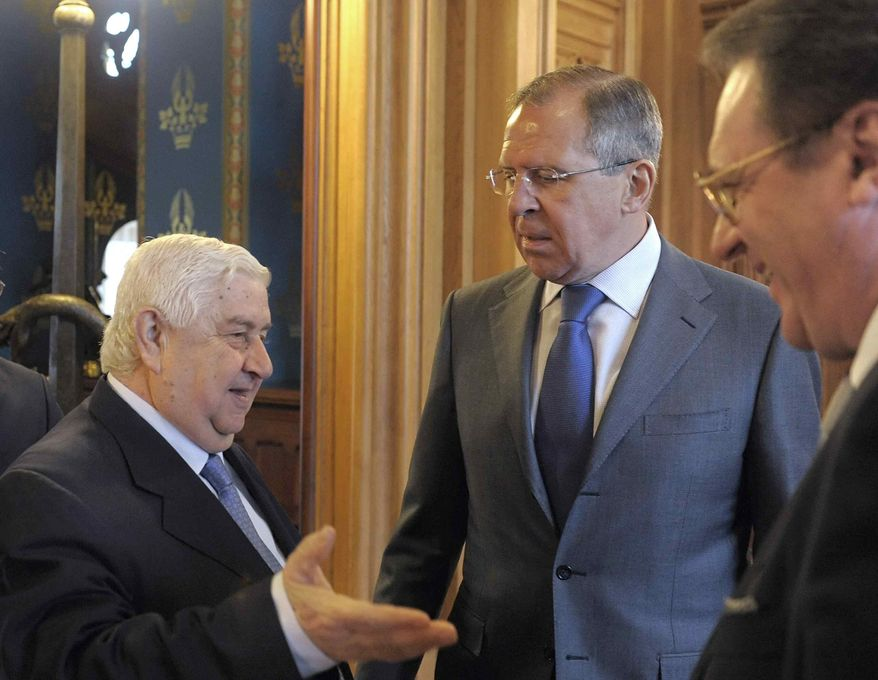 ** FILE ** Syrian Foreign Minister Walid Muallem (from left), Russian Foreign Minister Sergey Lavrov and Russian Deputy Foreign Minister Mikhail Bogdanov meet in Moscow on Tuesday, April 10, 2012. (AP Photo, Pool)