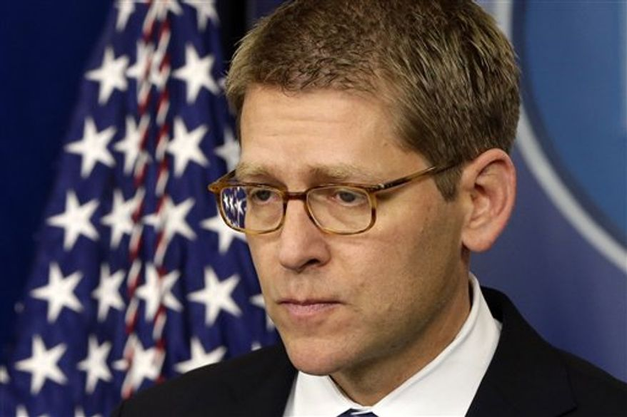White House press secretary Jay Carney listens to a follow up question regarding the school shooting in Newtown, Conn., after he told reporters that President Barack Obama is receiving updates on the situation, Friday, Dec. 14, 2012, during the daily press briefing at the White House in Washington. (AP Photo/Charles Dharapak)