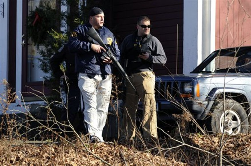 Law enforcement canvass an area following a shooting at the Sandy Hook Elementary School in Newtown, Conn., about 60 miles (96 kilometers) northeast of New York City, Friday, Dec. 14, 2012. An official with knowledge of Friday's shooting said 27 people were dead, including 18 children.  (AP Photo/Jessica Hill)