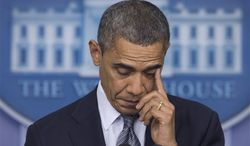 President Obama wipes his eye as he talks in the White House briefing room in Washington about the Connecticut elementary school shooting on Dec. 14, 2012. (Associated Press)