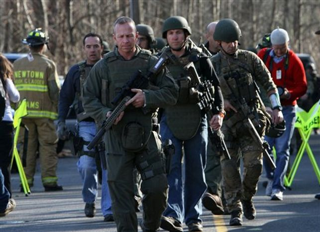 Heavily armed Connecticut State troopers are on the scene at the Sandy Hook School following a shooting at the school, Friday, Dec. 14, 2012 in Newtown, Conn. A man opened fire inside the Connecticut elementary school where his mother worked Friday, killing 26 people, including 18 children, and forcing students to cower in classrooms and then flee with the help of teachers and police. (AP Photo/The Journal News, Frank Becerra Jr.) MANDATORY CREDIT, NYC OUT, NO SALES, TV OUT, NEWSDAY OUT; MAGS OUT