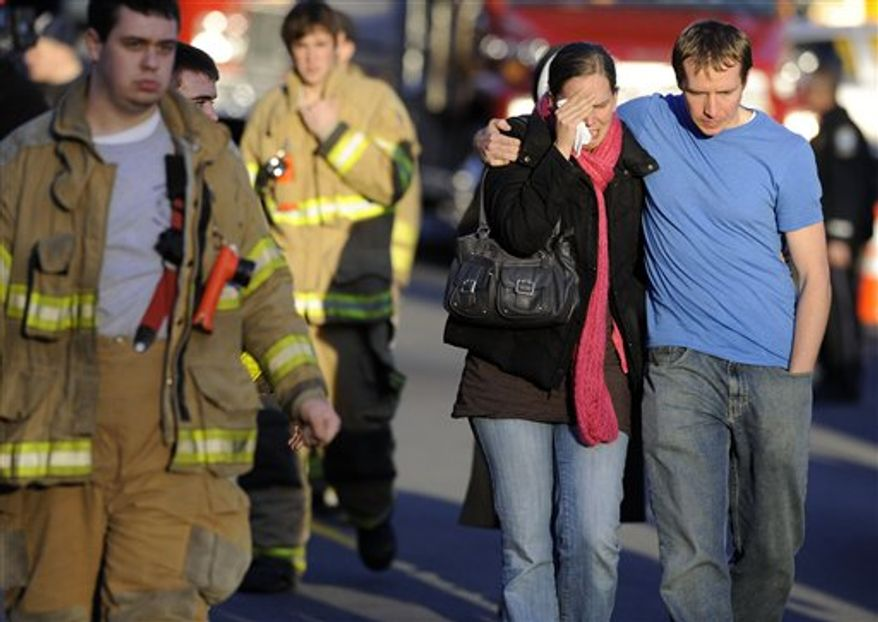 Victims family leave a firehouse staging area following a shooting at the Sandy Hook Elementary School in Newtown, Conn., about 60 miles (96 kilometers) northeast of New York City, Friday, Dec. 14, 2012. An official with knowledge of Friday's shooting said 27 people were dead, including 18 children.  (AP Photo/Jessica Hill)