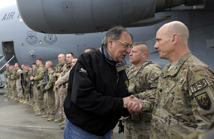 U.S. Defense Secretary Leon Panetta meets with troops at Kabul International Airport in Kabul, Afghanistan, Friday, Dec. 14, 2012, before boarding his plane and heading back to Washington. The Pentagon says it will send Patriot air defense missiles and 400 troops to Turkey as part of a NATO force meant to protect Turkish territory from potential Syrian missile attack. (AP Photo/Susan Walsh, Pool)
