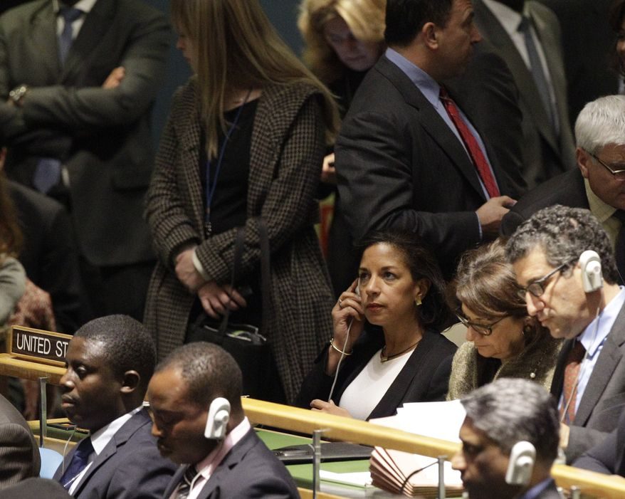 **FILE** U.N. Ambassador Susan E. Rice (center), listens as Palestinian President Mahmoud Abbas speaks Nov. 29, 2012, during a meeting of the United Nations General Assembly prior to a vote on a resolution on the issue of upgrading the Palestinian Authority's status to non-member observer state at the United Nations headquarters. (Associated Press)