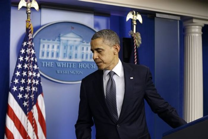 President Barack Obama leaves the podium after speaking about the school shooting in Newtown, Conn., Friday, Dec. 14, 2012, in the briefing room of the White House in Washington. (AP Photo/Cha