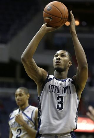 Georgetown forward Mikael Hopkins (3) prepares to take a free throw against Western Carolina during the second half of a college basketball game at the Verizon Center in Washington, on Saturday, Dec. 15, 2012. Georgetown won 81-68. (AP Photo/Jacquelyn Martin)